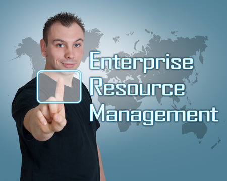 erm: Young man press digital Enterprise Resource Management button on interface in front of him