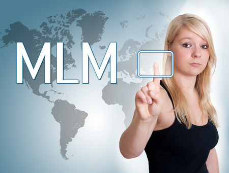 mlm: Young woman press digital Multi Level Marketing button on interface in front of her