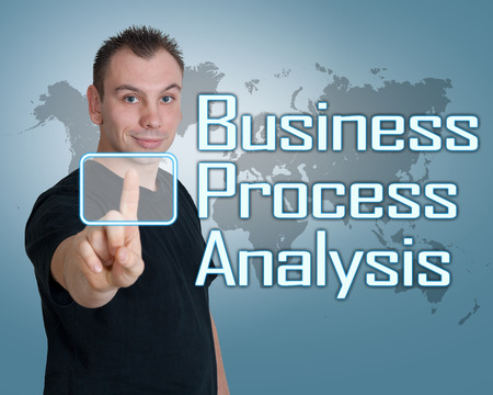 Young man press digital Business Process Analysis button on interface in front of him photo