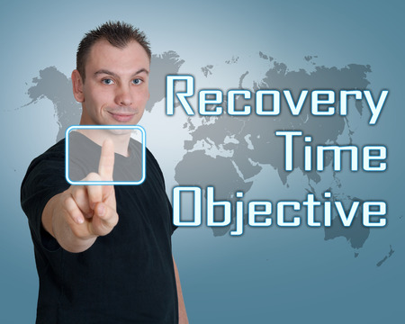 Young man press digital Recovery Time Objective button on interface in front of him photo