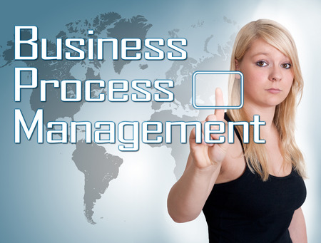 bpm: Young woman press digital Business Process Management button on interface in front of her