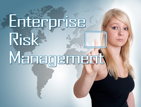 Young woman press digital Enterprise Risk Management button on interface in front of her