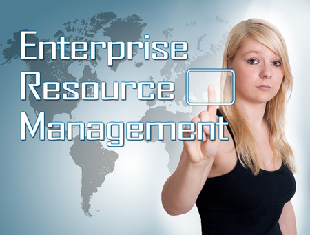 Young woman press digital Enterprise Resource Management button on interface in front of her
