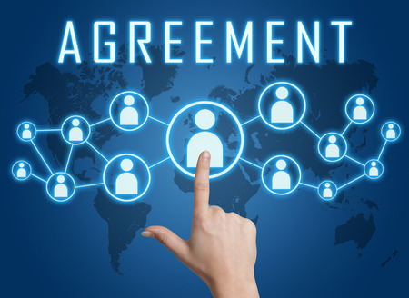 concur: Agreement concept with hand pressing social icons on blue world map background. Stock Photo