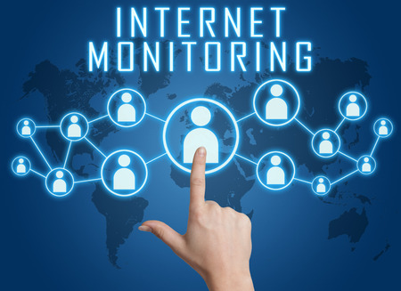 spying: Internet Monitoring concept with hand pressing social icons on blue world map background.