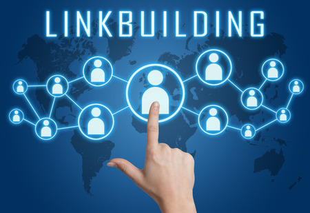 linkbuilding: Linkbuilding concept with hand pressing social icons on blue world map background. Stock Photo