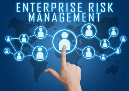 Enterprise Risk Management concept with hand pressing social icons on blue world map background.