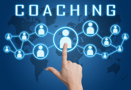 knowlage: Coaching concept with hand pressing social icons on blue world map background. Stock Photo
