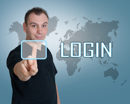 Young man press digital Login button on interface in front of him photo