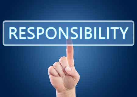Hand pressing Responsibility button on interface with blue background. photo