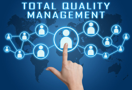 Total Quality Management concept with hand pressing social icons on blue world map background. Reklamní fotografie
