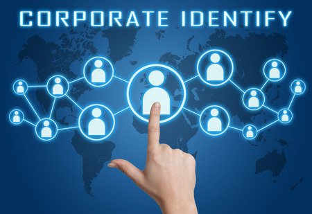 Corporate Identify concept with hand pressing social icons on blue world map background. photo