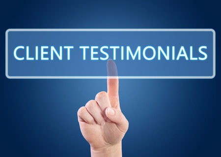 testimonial: Hand pressing Client Testimonials button on interface with blue background. Stock Photo
