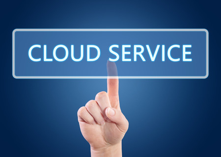 Hand pressing Cloud Service button on interface with blue background. photo
