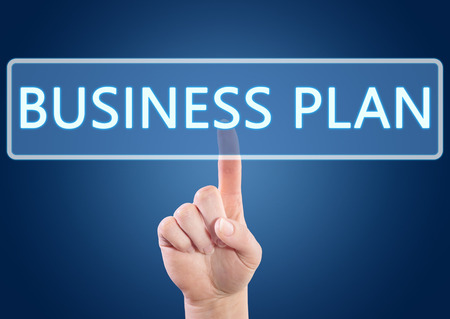 Hand pressing Business Plan button on interface with blue background. photo