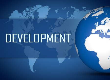 Development concept with globe on blue background photo
