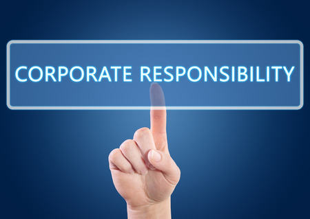 Hand pressing Corporate Responsibility button on interface with blue background. photo