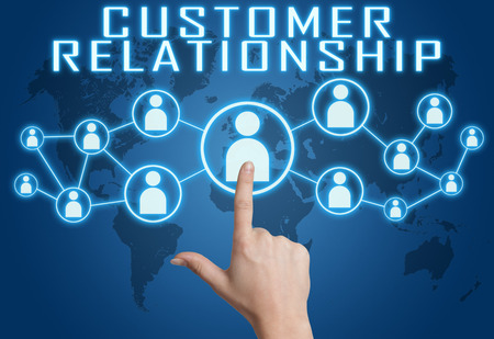 Customer Relationship concept with hand pressing social icons on blue world map background. photo