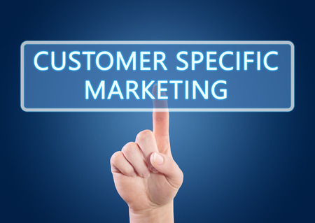Hand pressing Customer Specific Marketing button on interface with blue background. photo