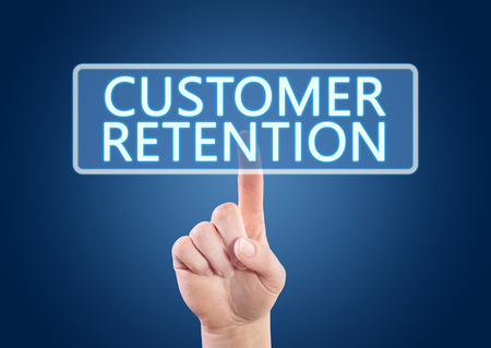 Hand pressing Customer Retention button on interface with blue background. photo