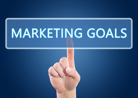Hand pressing Marketing Goals button on interface with blue background. photo