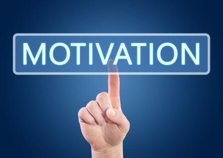 Hand pressing Motivation button on interface with blue background. photo