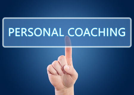 Hand pressing Personal Coaching button on interface with blue background. photo