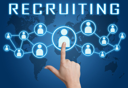 Recruiting concept with hand pressing social icons on blue world map background. Archivio Fotografico