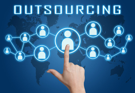Outsourcing concept with hand pressing social icons on blue world map background. 写真素材