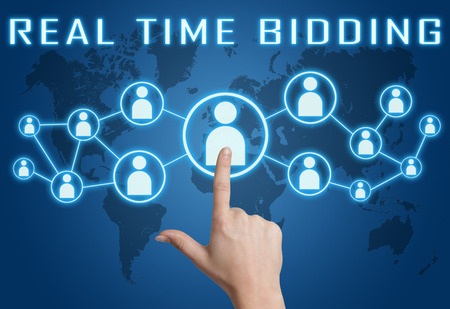 bidding: Real Time Bidding concept with hand pressing social icons on blue world map background. Stock Photo