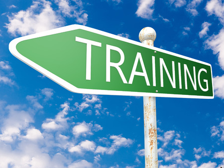 knowlage: Training - street sign illustration in front of blue sky with clouds. Stock Photo