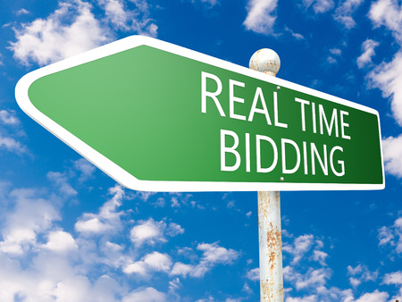 bidding: Real Time Bidding - street sign illustration in front of blue sky with clouds.