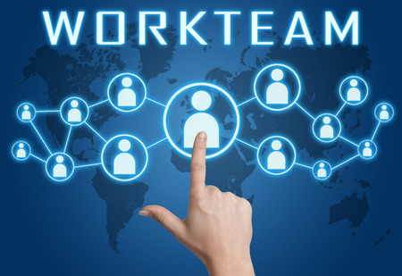 workteam: Workteam concept with hand pressing social icons on blue world map background. Stock Photo