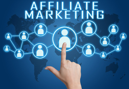 affiliates: Affiliate Marketing  concept with hand pressing social icons on blue world map background. Stock Photo
