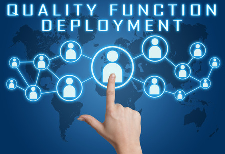 Quality Function Deployment concept with hand pressing social icons on blue world map background. Stock Photo