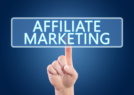 affiliates: Hand pressing Affiliate Marketing button on interface with blue background.