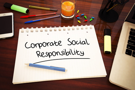 corporate responsibility: Corporate Social Responsibility - handwritten text in a notebook on a desk - 3d render illustration. Stock Photo