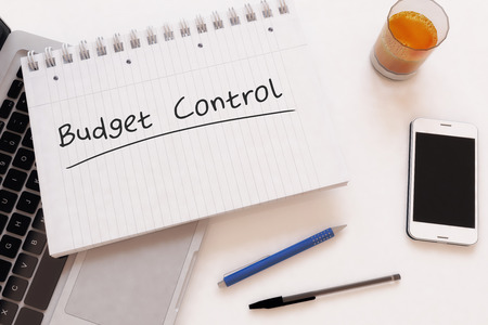 budgets: Budget Control - handwritten text in a notebook on a desk, 3d render illustration. Stock Photo