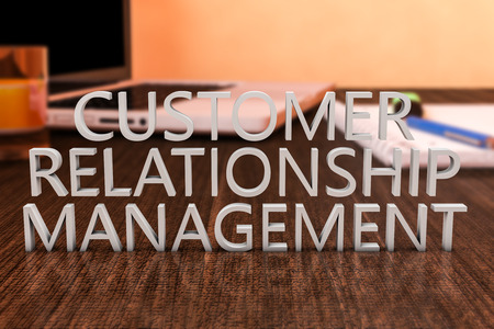 relationship strategy: Customer Relationship Management - letters on wooden desk with laptop computer and a notebook, 3d render illustration.