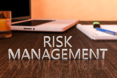 Risk Management - letters on wooden desk with laptop computer and a notebook. 3d render illustration.