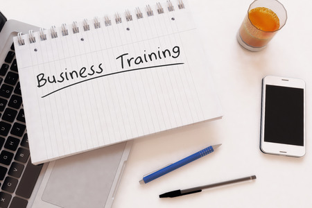 Business Training - handwritten text in a notebook on a desk - 3d render illustration. illustration