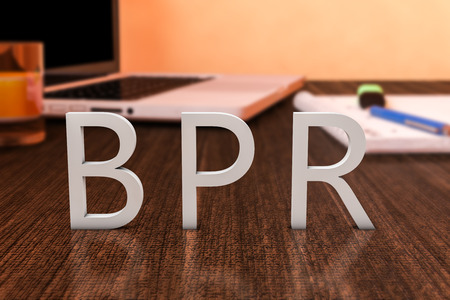 business process reengineering: BPR - Business Process Reengineering - letters on wooden desk with laptop computer and a notebook. 3d render illustration. Stock Photo