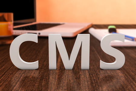 CMS - Content Management System - letters on wooden desk with laptop computer and a notebook. 3d render illustration.