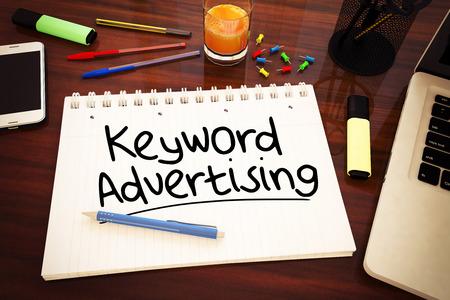keyword: Keyword Advertising - handwritten text in a notebook on a desk - 3d render illustration. Stock Photo