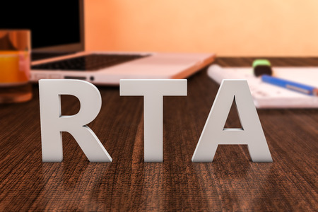 rta: RTA - Real Time Advertising - letters on wooden desk with laptop computer and a notebook. 3d render illustration.
