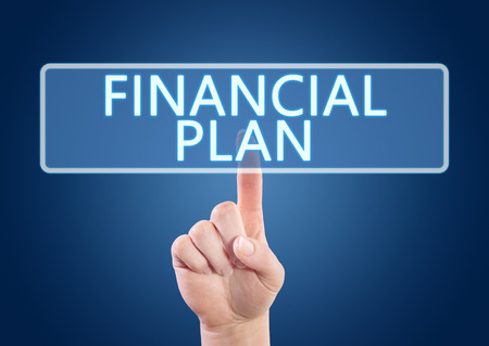 financial planning: Hand pressing Financial Plan button on interface with blue background. Stock Photo