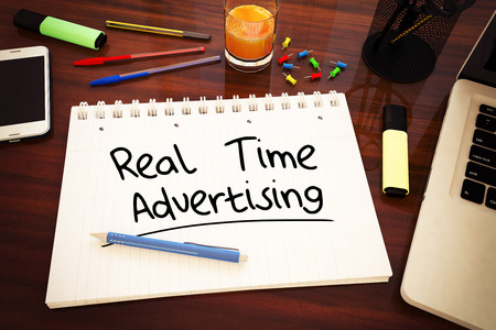 bidding: Real Time Advertising - handwritten text in a notebook on a desk - 3d render illustration.