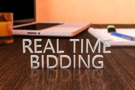bidding: Real Time Bidding - letters on wooden desk with laptop computer and a notebook. 3d render illustration.