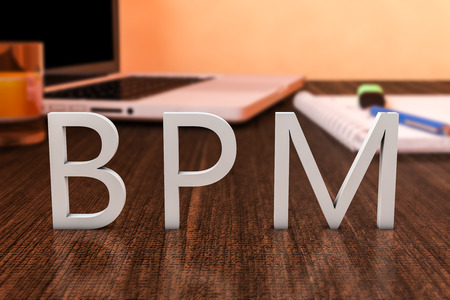 bpm: BPM - Business Process Management - letters on wooden desk with laptop computer and a notebook. 3d render illustration. Stock Photo
