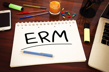 assessment system: ERM - handwritten text in a notebook on a desk - 3d render illustration. Stock Photo